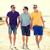 group of friends walking on the beach stock photo © dolgachov