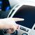 male hand pointing finger to monitor on car panel stock photo © dolgachov