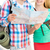 smiling couple with map and backpack in city stock photo © dolgachov