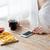 közelkép · nő · okostelefon · gyorsételek · emberek · technológia - stock fotó © dolgachov