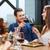 sorridente · família · almoço · juntos · mesa · de · jantar · casa - foto stock © dolgachov
