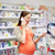 happy pregnant woman with smartphone at pharmacy stock photo © dolgachov