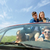 happy friends with map driving in cabriolet car stock photo © dolgachov