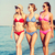group of smiling young women on beach stock photo © dolgachov
