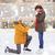 happy couple with engagement ring on skating rink stock photo © dolgachov