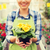 close up of woman holding flowers in greenhouse stock photo © dolgachov