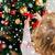 close up of child decorating christmas tree stock photo © dolgachov