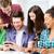 students looking at smartphone at school stock photo © dolgachov