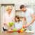 happy family making dinner in kitchen stock photo © dolgachov