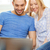 smiling happy couple with laptop at home stock photo © dolgachov