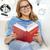 sorridere · studente · adolescente · lettura · libro · divano - foto d'archivio © dolgachov