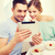 smiling couple with taking picture with tablet pc stock photo © dolgachov