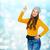 genç · kadın · gülen · işaret · yukarı · yalıtılmış - stok fotoğraf © dolgachov