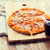 close up of pizza with coca cola on table stock photo © dolgachov