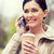 smiling woman with smartphone and coffee in park stock photo © dolgachov