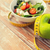 close up of green apple and measuring tape stock photo © dolgachov