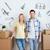 mosolyog · pár · nagy · dobozok · mozog · új · otthon - stock fotó © dolgachov
