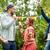 happy friends dancing at summer party in garden stock photo © dolgachov