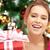 happy woman with gift box and christmas tree stock photo © dolgachov