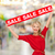 smiling woman in dress with red sale sign stock photo © dolgachov