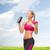 vrouw · drinkwater · fles · fitness - stockfoto © dolgachov