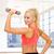 幸せ · スポーティー · 女性 · ダンベル · 上腕二頭筋 · スポーツ - ストックフォト © dolgachov