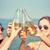 feliz · mulheres · jovens · bebidas · praia · férias · de · verão - foto stock © dolgachov