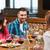 amigos · almoço · juntos · restaurante · comida · vinho - foto stock © dolgachov