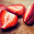 close up of ripe red strawberries on cutting board stock photo © dolgachov