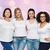 group of happy different women in white t shirts stock photo © dolgachov