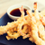 close up of deep fried shrimps and soy sauce stock photo © dolgachov