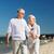 boldog · idős · pár · tart · kéz · tengerpart · napos · idő - stock fotó © dolgachov