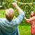 happy friends playing badminton at summer garden stock photo © dolgachov