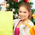 happy woman with shopping bags and christmas tree stock photo © dolgachov