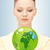 woman holding green globe in her hands stock photo © dolgachov