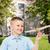 smiling little boy holding a wooden airplane model stock photo © dolgachov