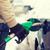 close up of male refilling car fuel tank stock photo © dolgachov