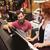 man and woman playing piano at music store stock photo © dolgachov