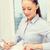 zakenvrouw · laptop · bestanden · telefoon · business · communicatie - stockfoto © dolgachov