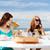 girls in cafe on the beach stock photo © dolgachov