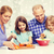 happy family with two kids making dinner at home stock photo © dolgachov