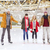 happy friends waving hands on skating rink stock photo © dolgachov