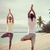 couple making yoga exercises on beach from back stock photo © dolgachov