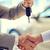close up of handshake in auto show or salon stock photo © dolgachov