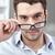 üzletember · elvesz · el · szemüveg · fiatal · mosolyog - stock fotó © dolgachov