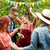 happy friends dancing at summer party in garden stock photo © dolgachov