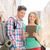 smiling couple with tablet pc and backpack in city stock photo © dolgachov