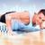 smiling man doing push ups in the gym stock photo © dolgachov