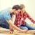casal · almofadas · piso · mulher · relaxar - foto stock © dolgachov