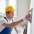 улыбаясь · строителя · рабочих · инструментом · здании - Сток-фото © dolgachov